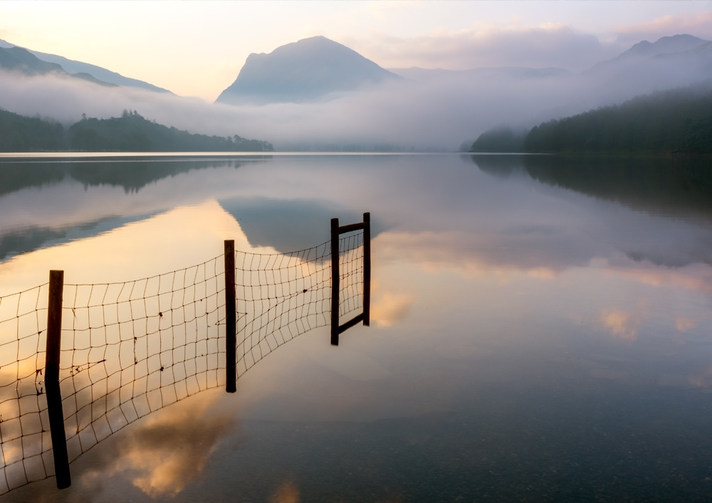 Northern Wild landscape Photography - Single fence on Buttermere during a very atmospheric misty morning, Lake District UK
