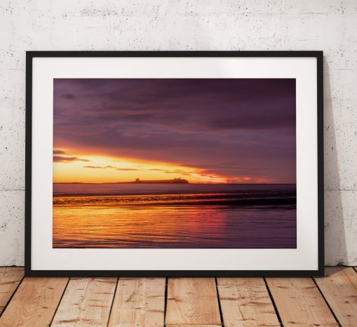 A dramatic sunrise over the Farne Islands in Northumberland, taken from Bamburgh beach. United Kingdom. Wall Art, Fine art photography
