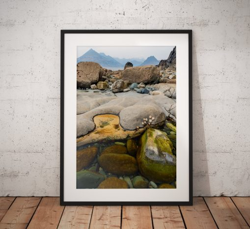 Colourful rock pool photograph  taken at the village of Elgol on the Isle of Skye looking towards the Cuillins in the Scottish Highlands, UK