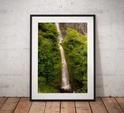 Ireland photograph showing the Devils Chimney waterfall surrounded by lush woodland in Sligo, County leitrim.  Ireland.