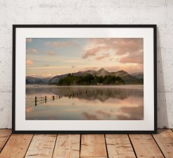 Lake District Photography showing a misty sunrise over Derwentwater with Derwent Isle emerging from the mist. From Crow park in Keswick, UK