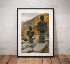 Photo of two beautiful mother and child slate statues looking down into Honister Pass in the Lake District, England. Wall Art, photograph